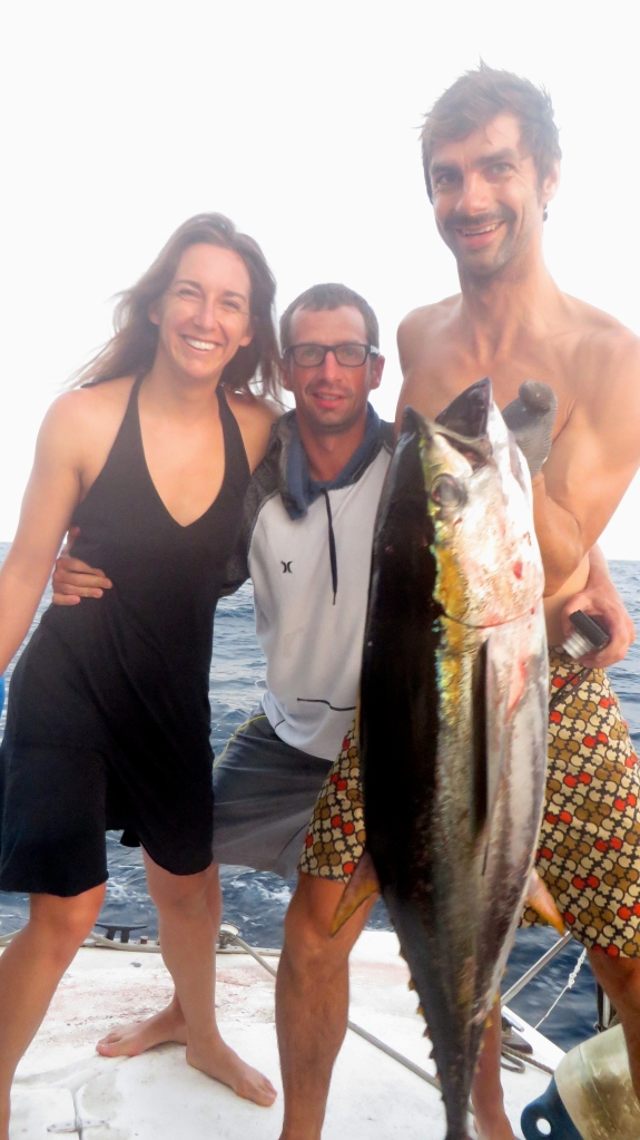 Ryan, Sabrina, and Pierre marvel at our first yellowfin tuna